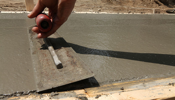 Use a steel trowel for a smooth finish