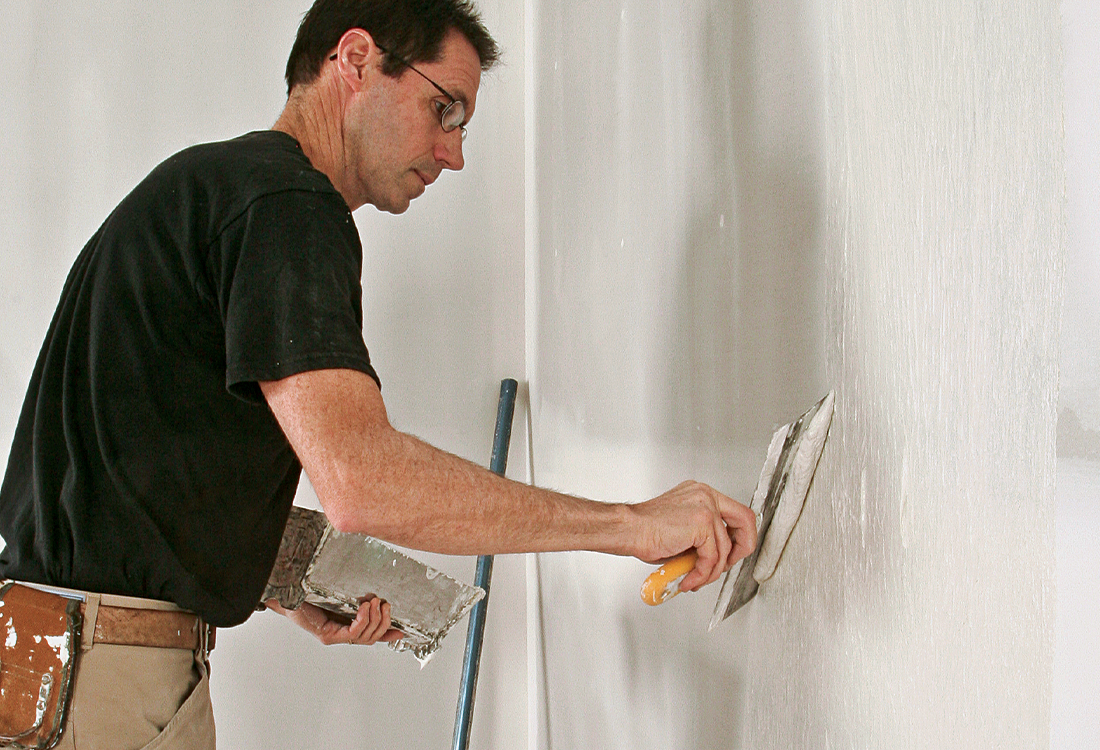 scrape off excess drywall compound