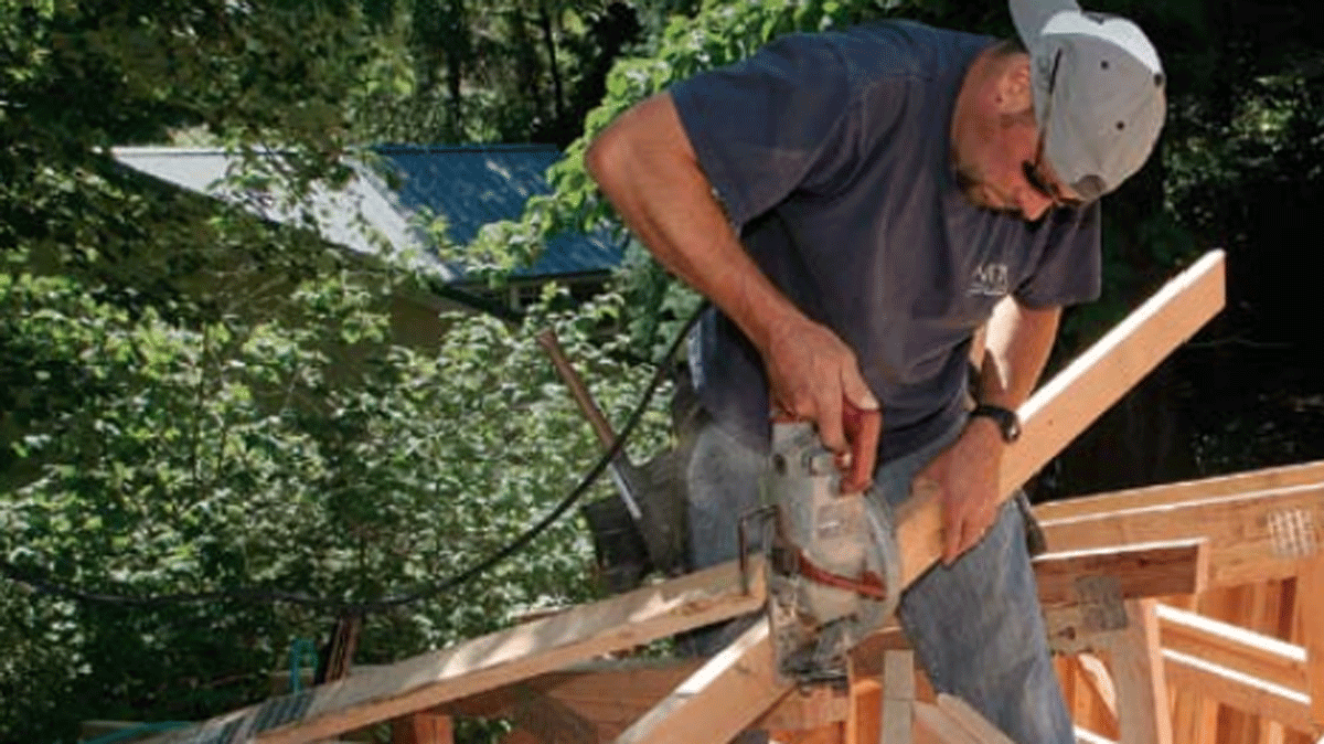 worker constructing a roof