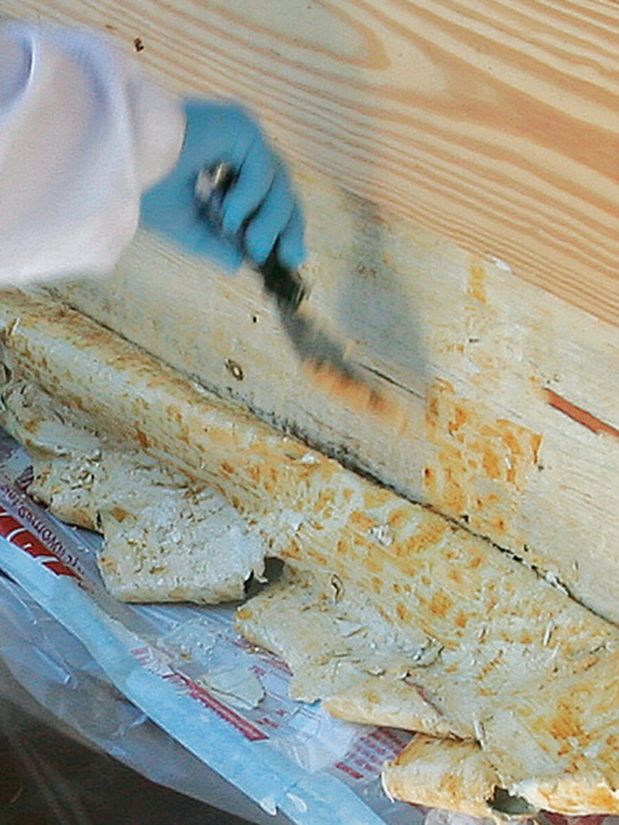 scraping off old paint with peel away