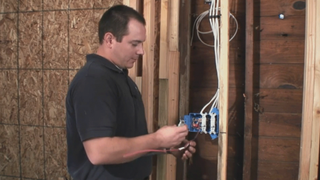 man installing 3 way light switch