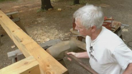 man assembling a timber frame joint