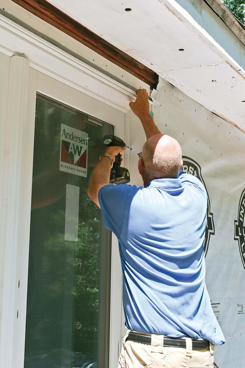 Once the door is shimmed and square, install the jamb screws, and move inside to check the door's operation.