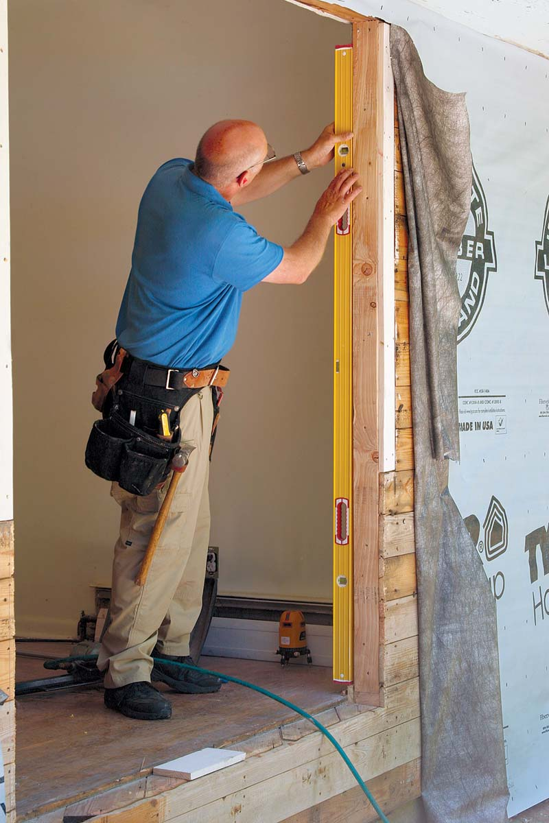 Use a 6-ft. level to check the door opening for plumb and the rough sill for level.