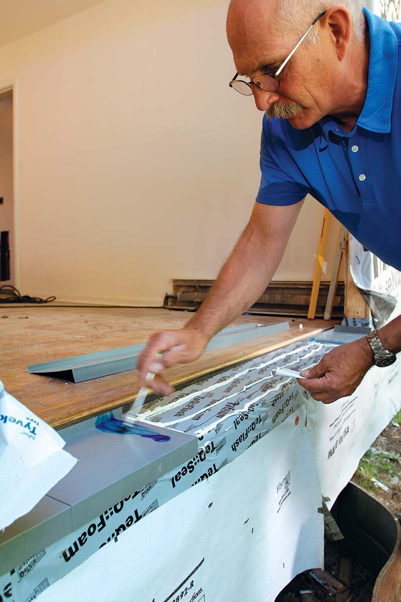 This PVC sill pan is shipped in three parts and is field-assembled to match the width of the opening.