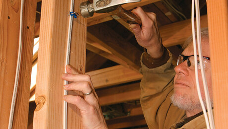 fastening electrical cable to framing