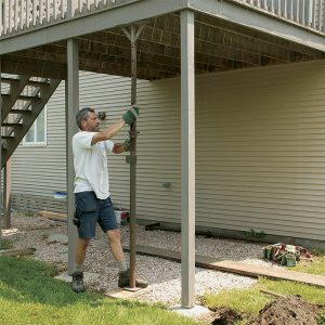 Add temporary support. Before excavating the footings, brace the deck with temporary support columns. Set the columns plumb, and tack them in at the top with staging nails or structural screws.