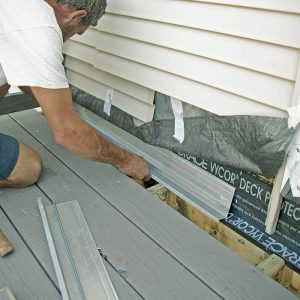 Layers of protection. After applying a strip of self-adhering membrane to the top of the ledger and onto the wall, install new flashing (everflashing.org) over the ledger.