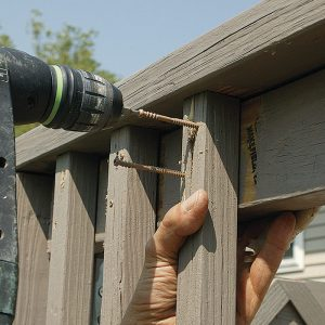 Secure the railing. Remove the balusters from each rail section, and replace the bad ones. For a better connection, drill pilot holes into each end of the balusters, and fasten them to the 2x4 rails with four screws, two at each end.