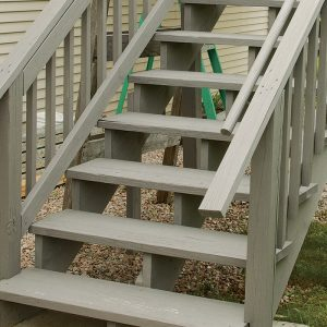 According to code, stairs need at least one handrail continuous from top to bottom and whose ends either terminate onto newels or return safely. Here, the handrail ends run long and don't have safety returns onto the guardrail.