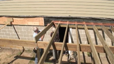 installing deck joists for an elevated deck