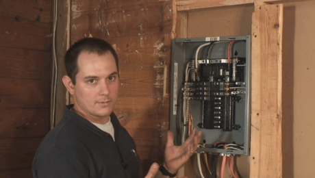 electrician working on subpanel