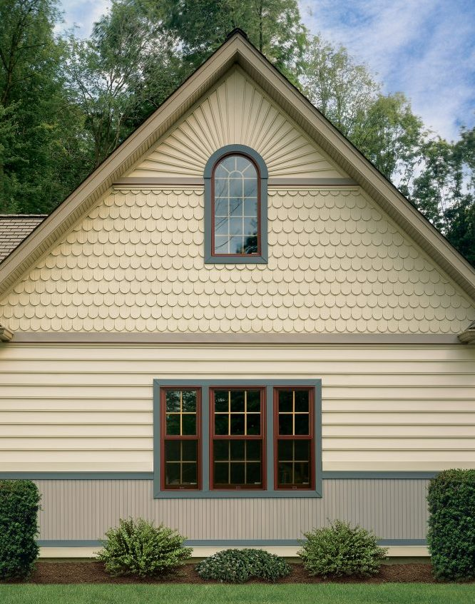 Look again. Vinyl siding comes in as many forms as real wood, including trim pieces.