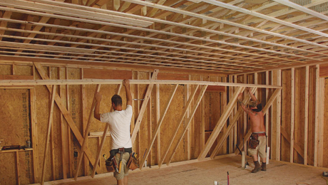 two workers framing
