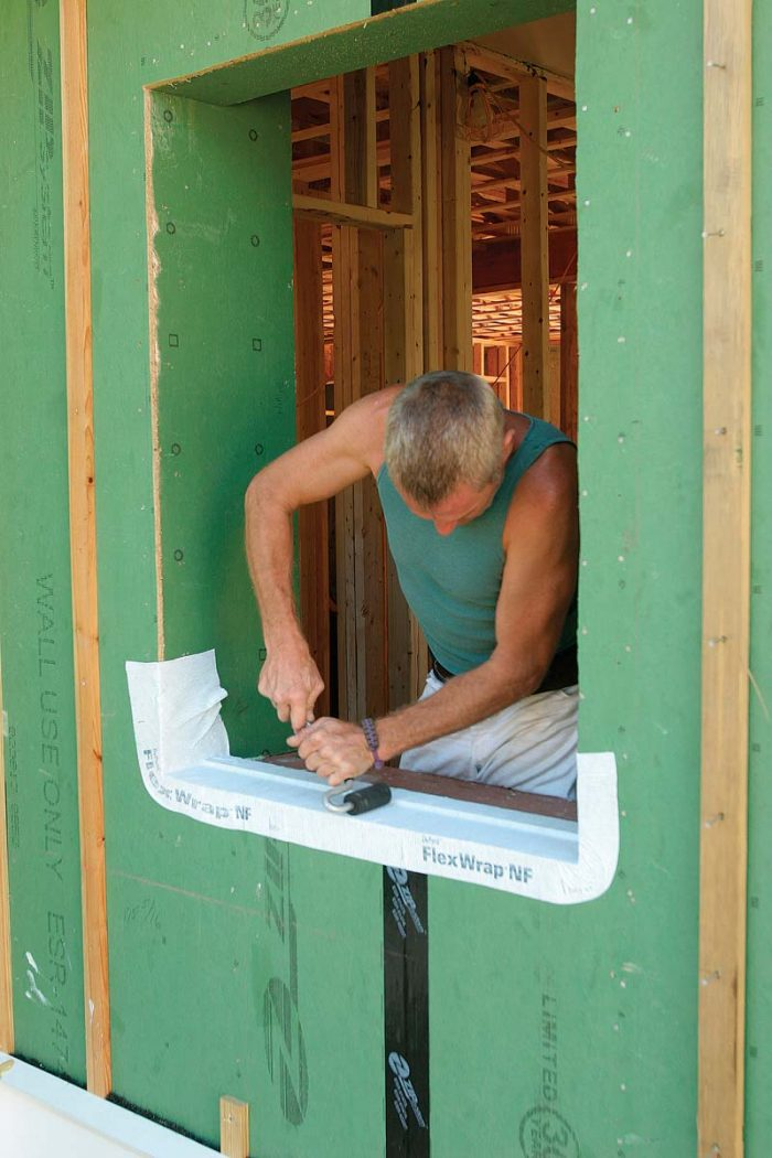 A sloped sill and back dam are built in place with a piece of beveled clapboard siding and a 1x4.