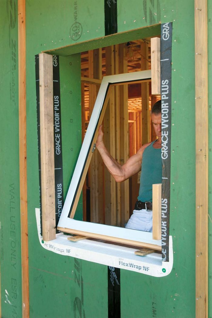 he window frames (free of their heavy sashes) are tipped into place.