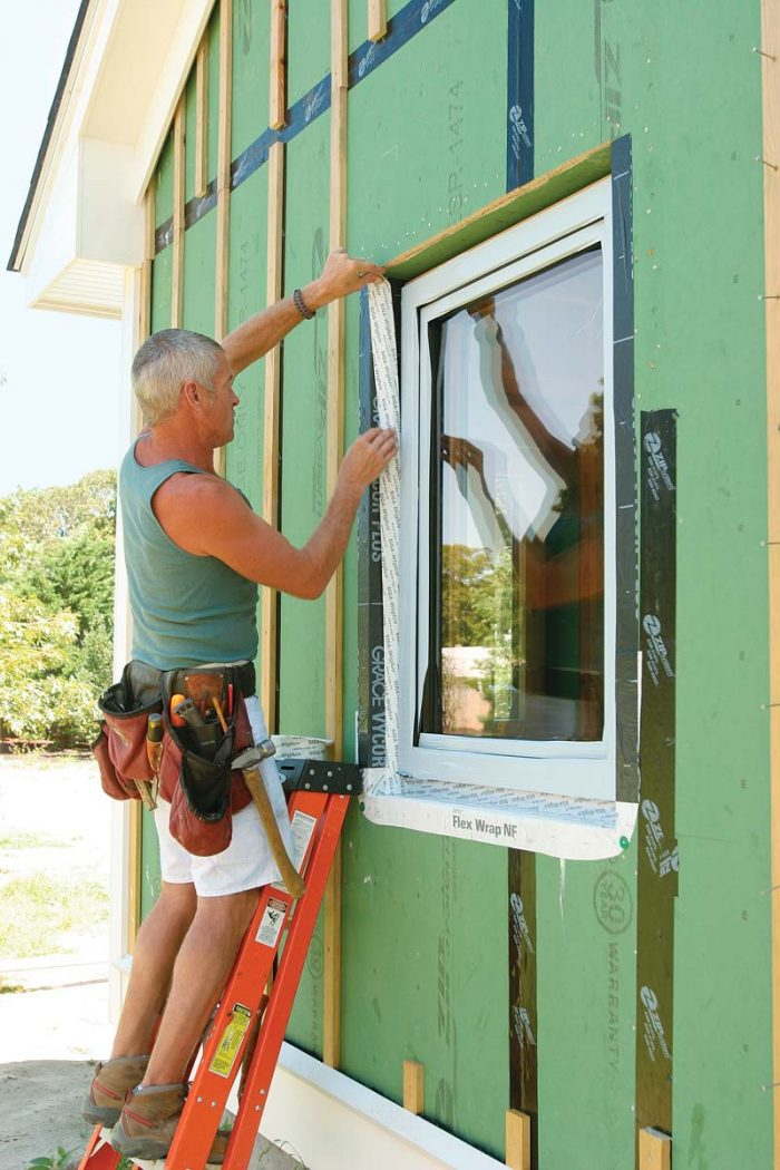 install Siga Wigluv tape from the sides of the rough opening to the wooden frame that extends around the perimeter on all four sides of the window.