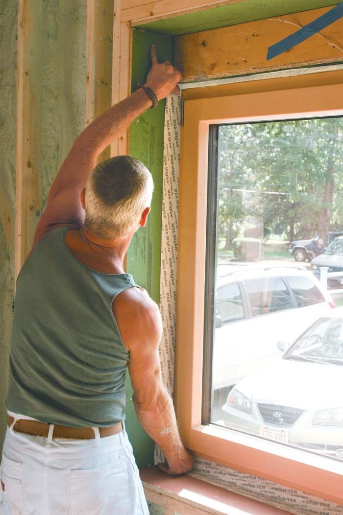 1⁄2-in. space that remains around the wooden frame to be fully sealed with low-expansion spray foam