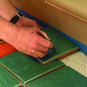 mark cuts on the tile