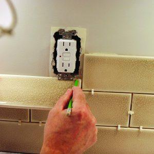 backsplash tile fitting around outlet