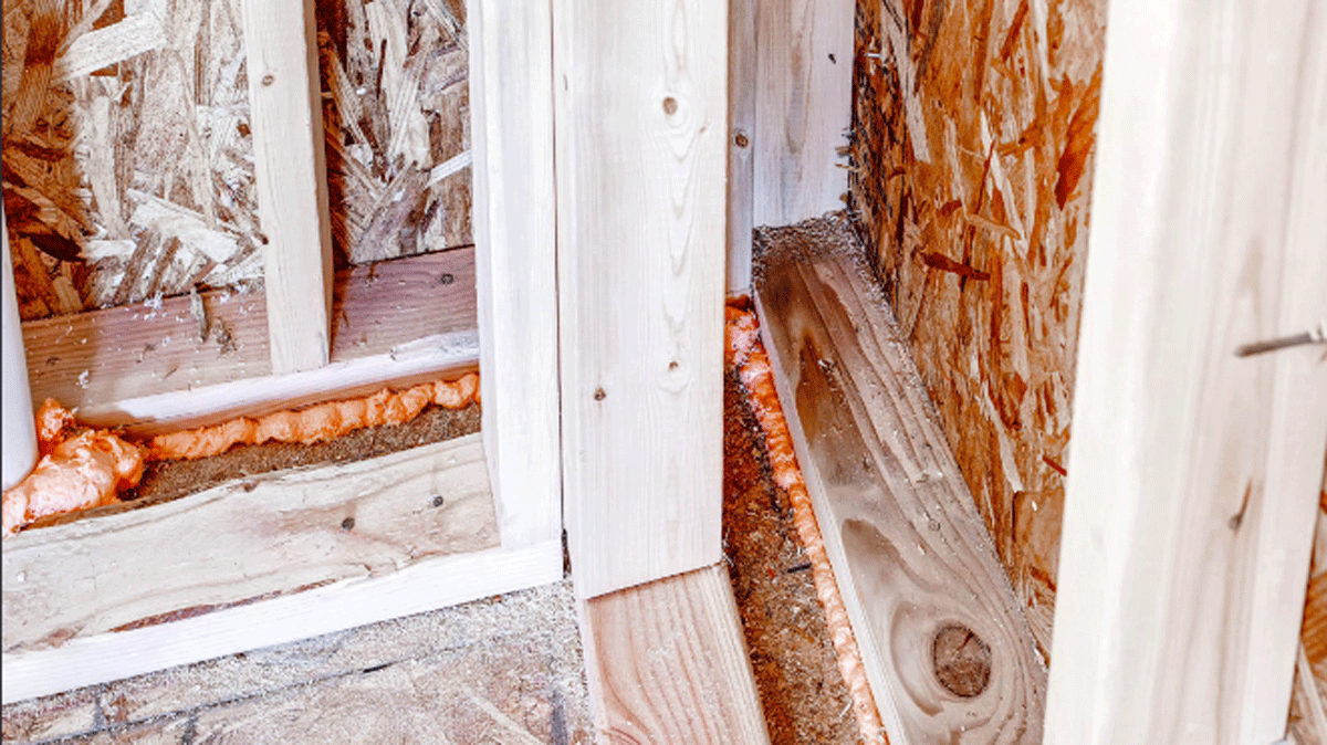 An advanced corner, with two studs instead of three, leaves more room for insulation even as it saves on lumber. Spray foam was used to air-seal around windows, behind outlets, at bottom plates, and at any holes for wiring or plumbing. Ladder blocking was used at interior/exterior wall intersections.