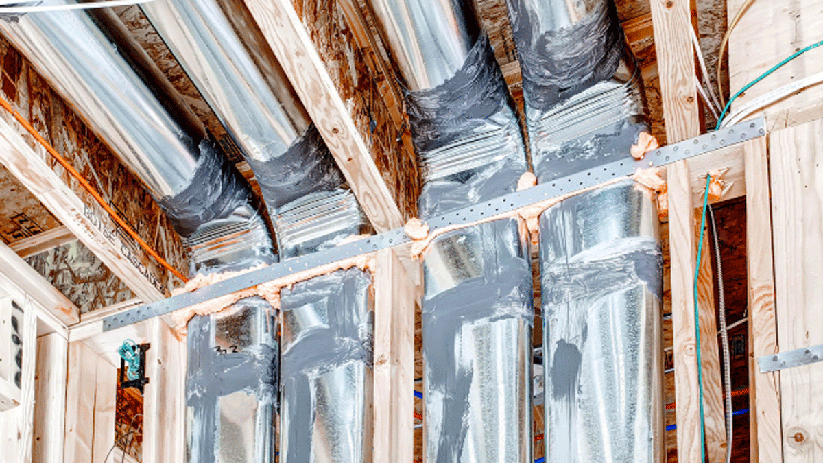 HVAC ducts are sealed with mastic and checked for airtightness. Heated or cooled air reaches its destination with a loss of less than 7%. A nonhardening sealant was applied along the top plate of walls bordering the attic. It forms an airtight gasket when drywall is screwed in place.