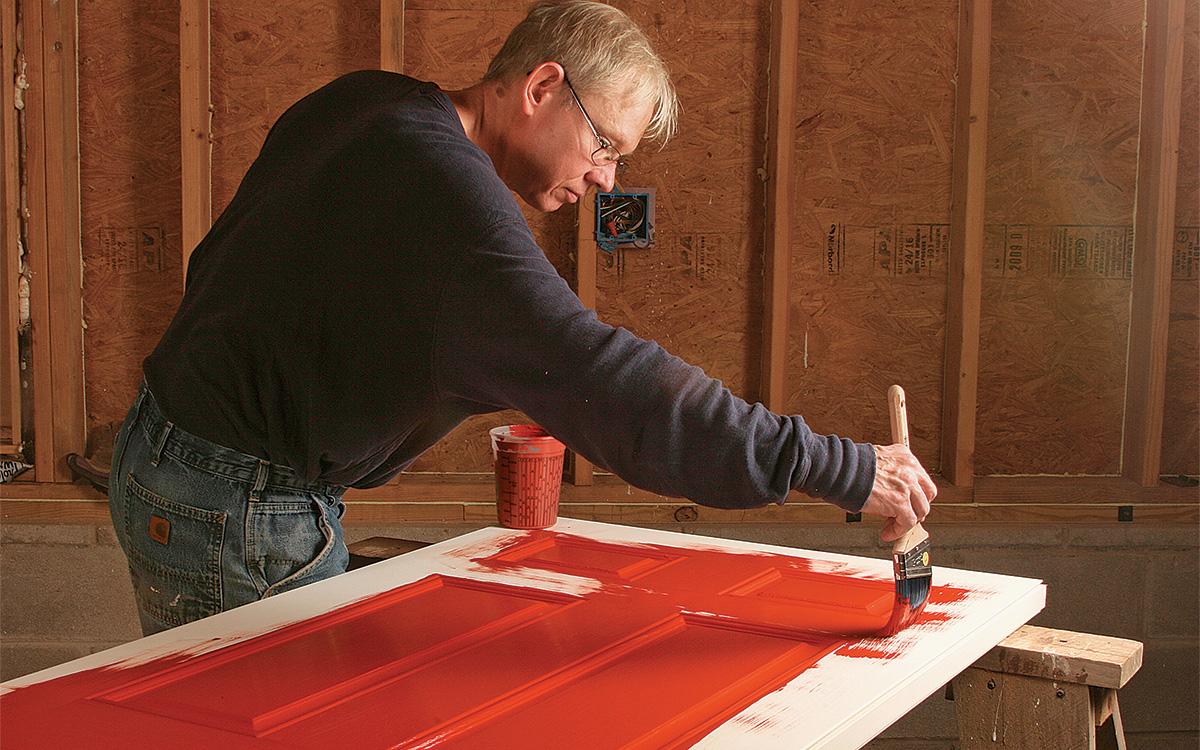 brush painting a steel door