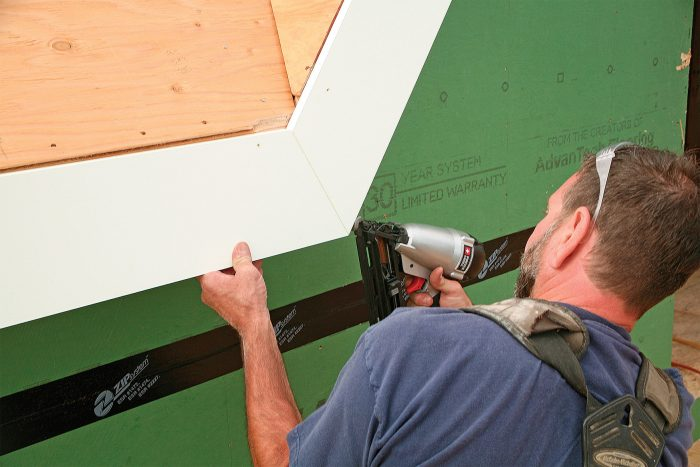 One nail helps. After finding the correct angle, cut and glue the fascia pieces, making sure they stay even with the plane of the roof sheathing. A 16-ga. nail provides insurance.