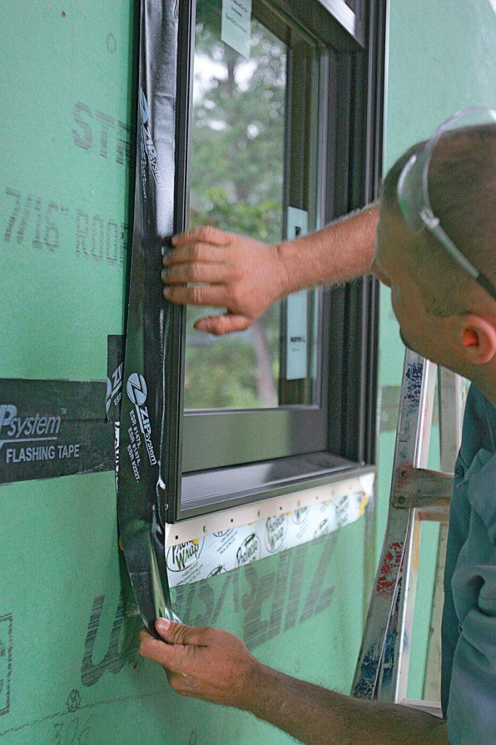 Zip System Tape is 3-3⁄4 in. wide, which is wide enough for it to be adhered to the sheathing, across the nailing fin, and onto the side of the window frame.