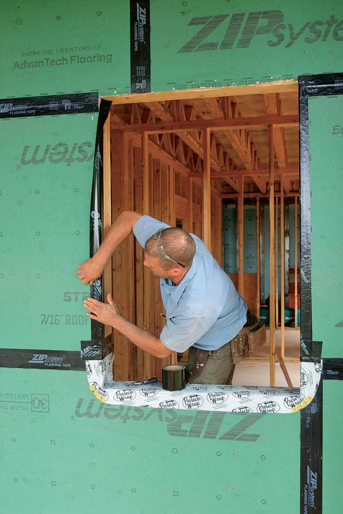 Cover each side of the opening with a piece of flashing tape that bridges the gap between sheathing