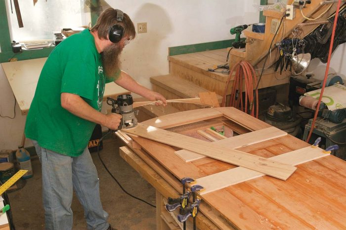 Cut the arched top. The door has an arched top that's cut in three passes with a router on a trammel arm.