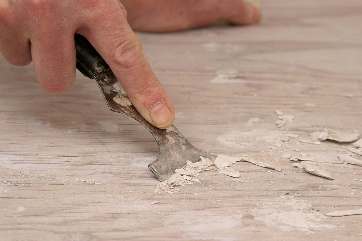 Scrape up any lumps of dried drywall mud, and sweep the floor clean.