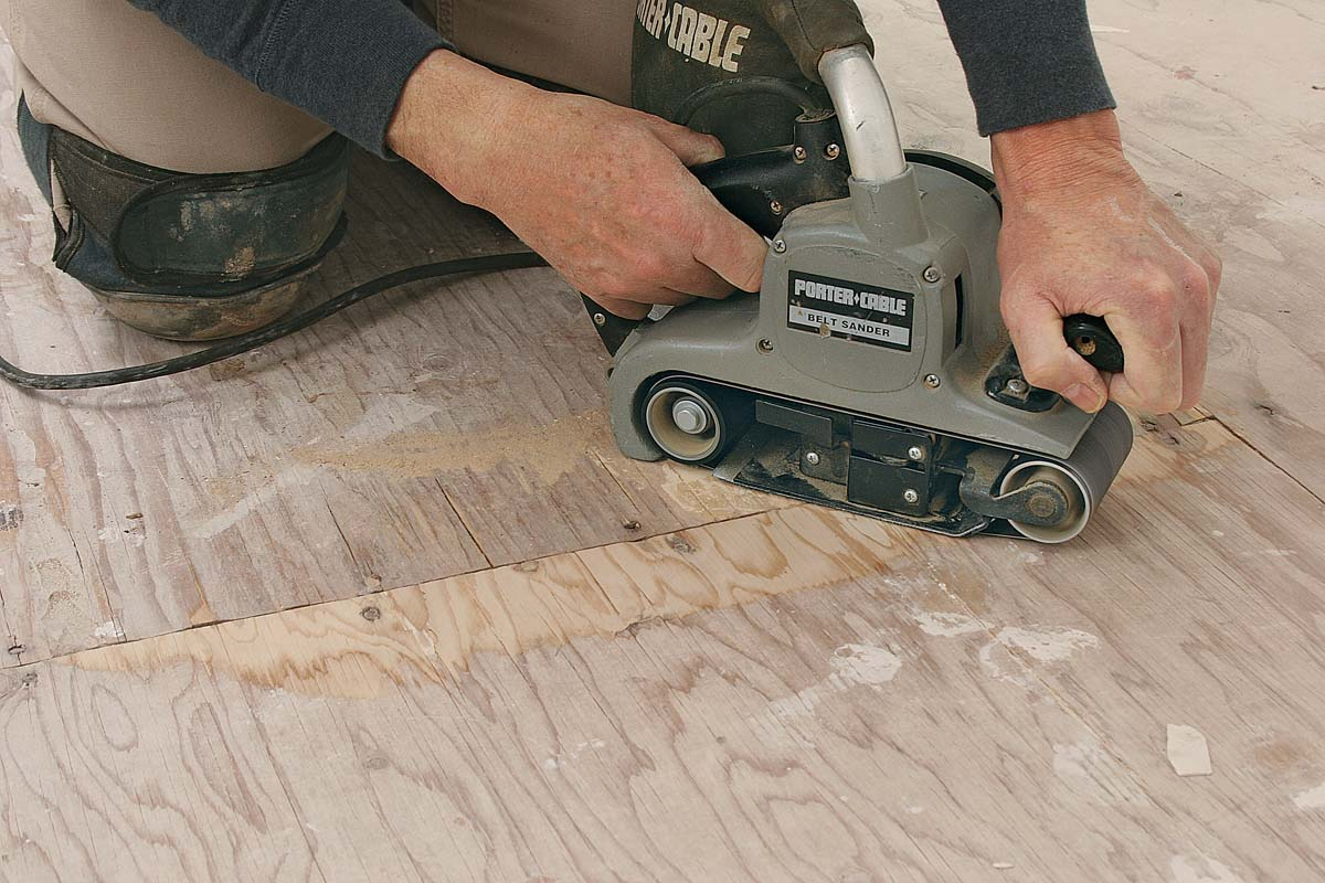 Fix any problems with the subfloor. Set any fasteners that stick up, and sand flush any joints with significant lippage.