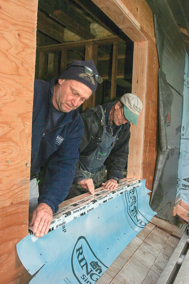 To use an LAF, you squeeze or spread a generous amount on the surfaces that need flashing—generally the rough sill, the rough jambs, the head, and a 6-in.- to 8-in.-wide band of the sheathing around the opening