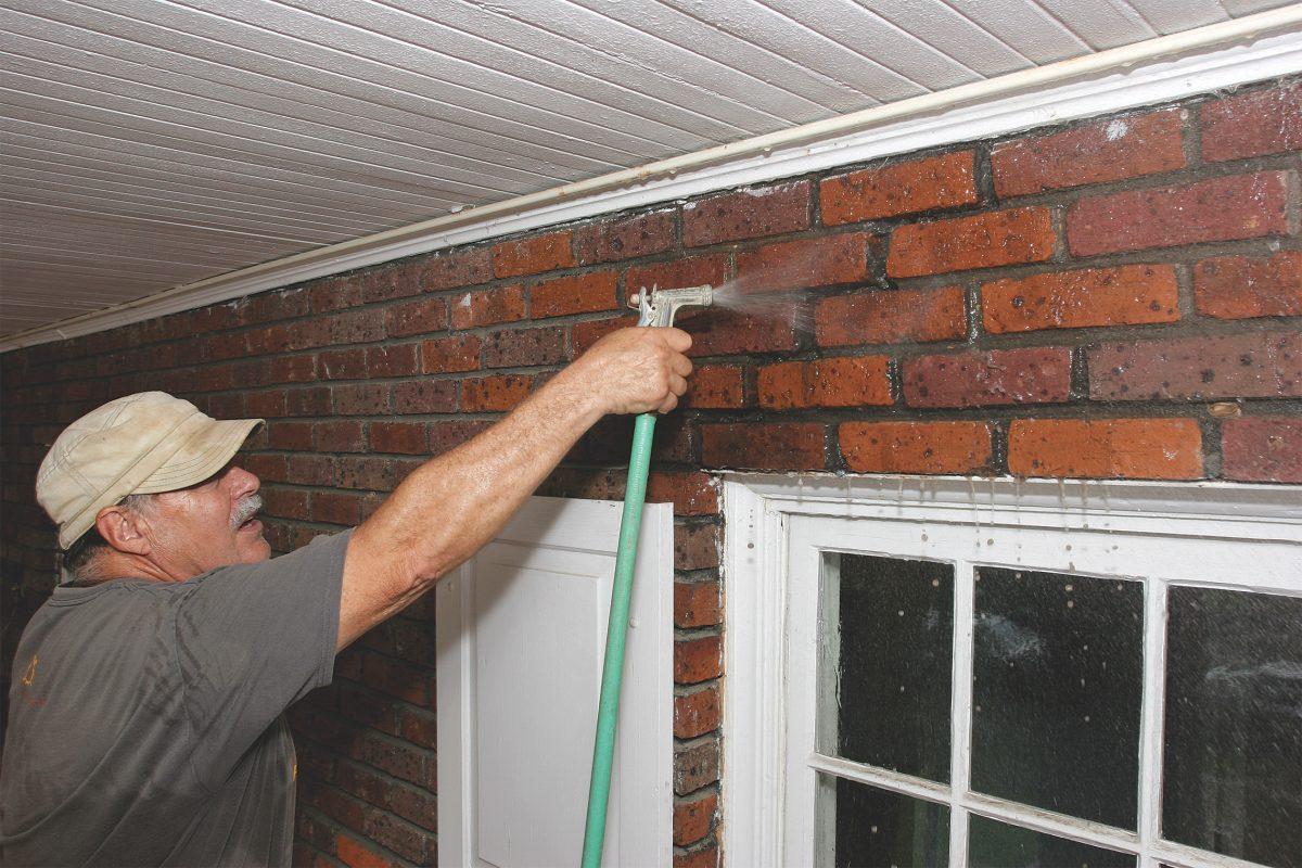 dampening the area of the broken bricks