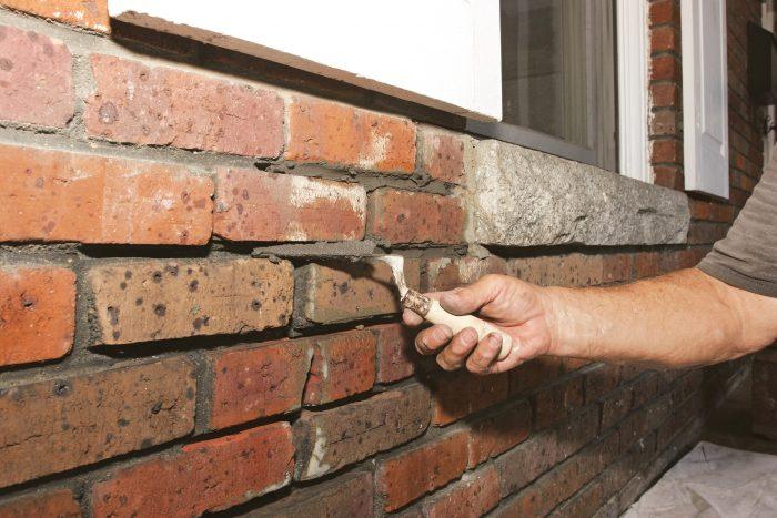 carry the mortar with the tuck pointer upside down when repairing broken bricks