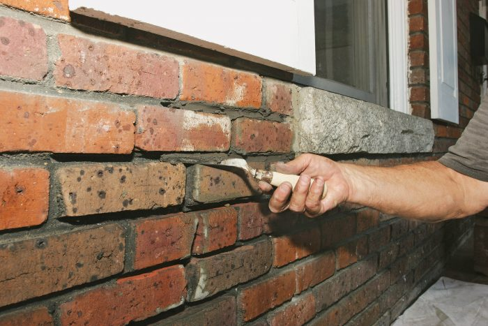 rotate the tuck pointer into the joint of the broken bricks