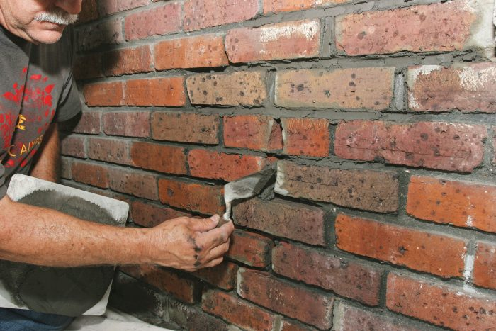 using a brick trowel for short vertical joints