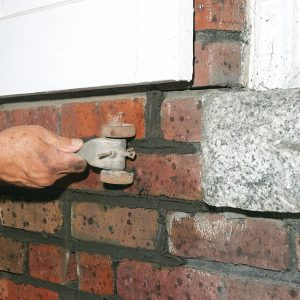 rake out the excess mortar from the brick
