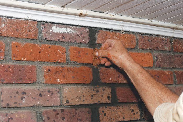 pack mortar into the broken bricks by hand