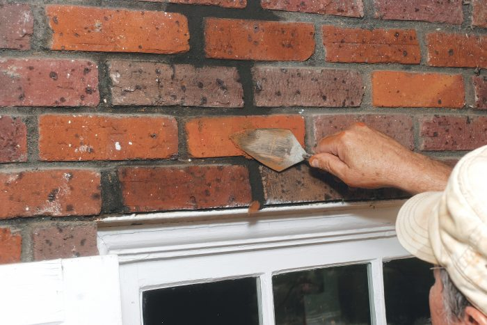 fill the broken bricks and then smear it out with a trowel