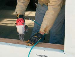 nail a piece of siding along the rough sill with 13⁄4-in. roofing nails
