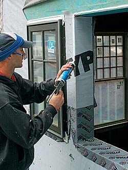 Run a 1⁄2-in.-wide bead of caulk along the sides and top of the window opening