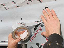 Tape along the bottom of the flap and at the corners with housewrap tape