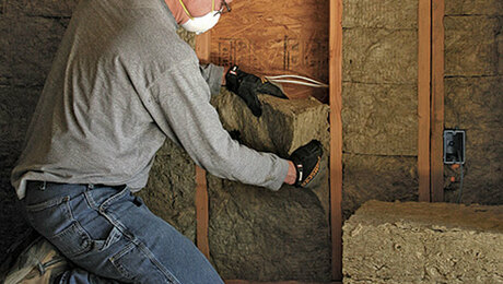 Andy Engel installing mineral wool