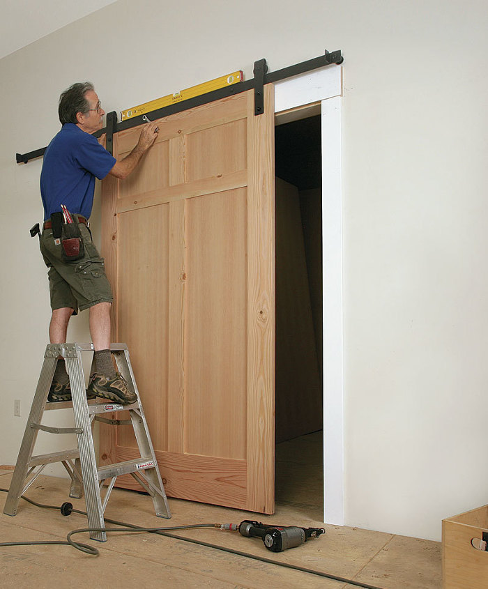 how to install a sliding barn door fine homebuilding. Black Bedroom Furniture Sets. Home Design Ideas