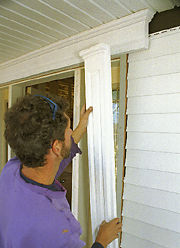 At A Front Door, A Furring Strip Lifts The Door Trim Enough To Let Siding  Panels Tuck In Behind.