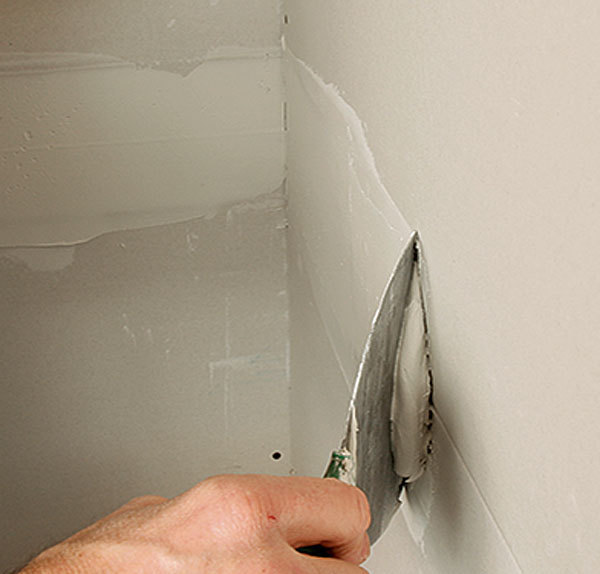 Bed The Tape With A Drywall Knife. Starting From The Center, Bed The Tape  By Moving The Knife Against The Joint With Medium Pressure, Angled About  45°.