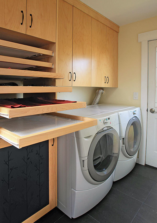 Laundry Room Trifecta: Hamper, Storage Area, And Drying Racks