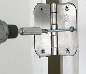 Secure the door with a long screw.